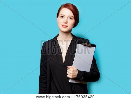 Beautiful Young Woman With Clipboard On The Wonderful Blue Background