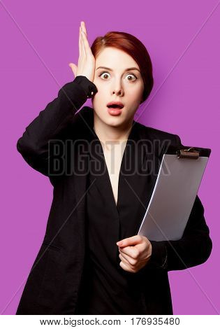Beautiful Surprised Young Woman With Clipboard On The Wonderful Purple Background