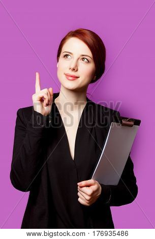 Beautiful Young Woman With Clipboard On The Wonderful Purple Background