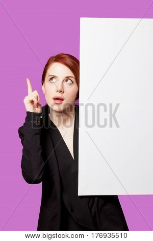 Beautiful Surprised Young Woman With Big Empty Poster On The Wonderful Purple Background