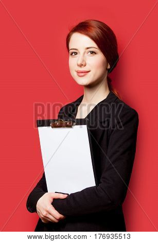 Beautiful Young Woman With Clipboard On The Wonderful Red Background