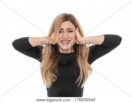Blonde woman closing ears with fingers. Isolated on white background.