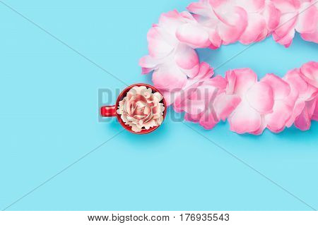 Beautiful Hawaiian Lei And Rose In Red Cup On The Wonderful Blue Background
