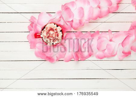 Beautiful Hawaiian Lei And Rose In Red Cup On The Wonderful White Wooden Background