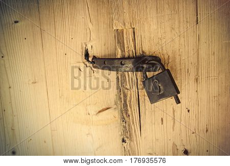 photo of beautiful old lock of the wooden gate doors
