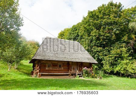 Photo Of Beautiful View Of Village House On The Wonderful Trees Background