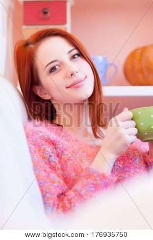 Photo Of Beautiful Young Woman With Cup Of Coffee Relaxing On The Sofa
