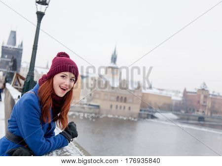 Beautiful Young Woman Standing On The Bridge Near Stone Fence