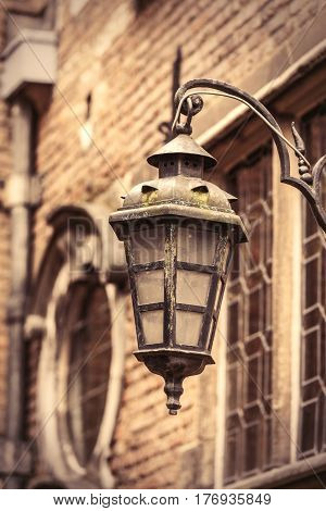 photo of beautiful and old vintage lantern on the wonderful building