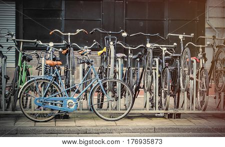 photo of beautiful view on chain of cool bicycles on the parking