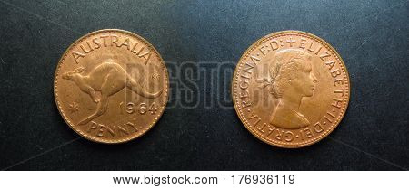 Vivid Vintage pre-decimal coins 1964 Copper Australian Penny. Showing Queen Elizabeth 11 with the Australian Kangaroo on the reverse. This was the last year of the minting this coin. coins penny obverse reverse money cash change currency pre-decimal coina