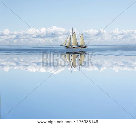 Sailboat. Sailboat ailboat sails into the calm in the sea bay.