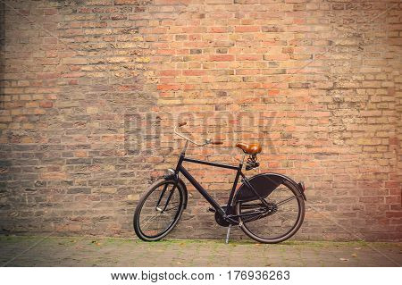 Photo Of The Beautiful Bicycle Near The Wonderful Bricks Building