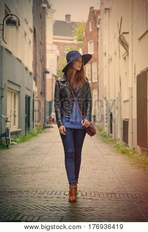 beautiful young woman walking on the street and exploring the town