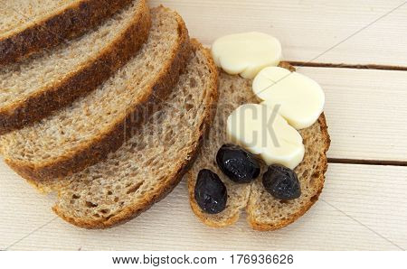 Bran bread and besides black olives, cheese, the most beautiful breakfast cheese and black olives.In different concepts bread, olive and cheese pictures,