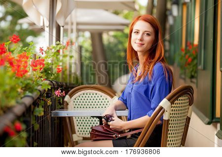 Beautiful Young Woman Sitting In The Cafe And Resting