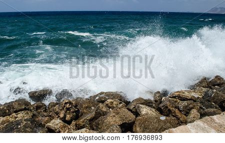 Big wave the azure sea is divided into bryzkami on the rocky shore