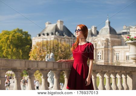 Beautiful Young Woman Walking In The Park On The Mansion Background