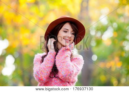 Photo Of Beautiful Young Woman Standing In The Park And Smiling