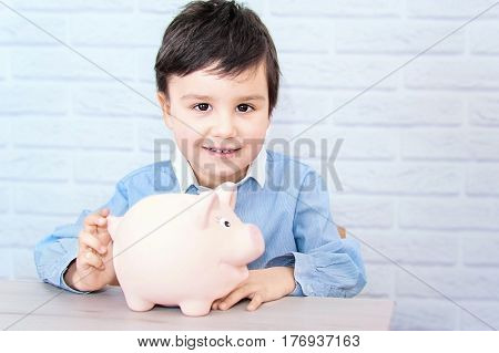 boy with pig piggy bank. childhood money investment and happy people concept