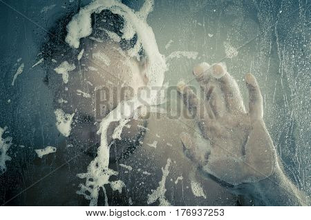 Stressed Man Taking A Shower Standing Under Flowing Water And Draws A Question Mark From Lather In S