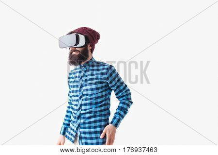 Man with the VR gadget standing on the gray background.