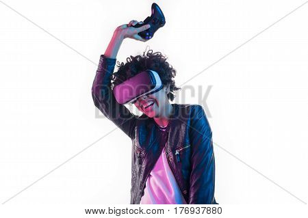 Cheerful woman holding hand up with the gamepad and having the virtual reality experience.
