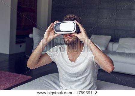 Young man with headset playing virtual reality