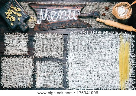 Rustic style template for food and drink industry. Burlap frames on dark wood background with flour pack and pasta. Wooden cutting board with text 'Menu' as title bar