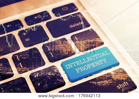 INTELLECTUAL PROPERTY: Close up green button keyboard computer. Vintage Effects. Digital Business and Technology Concept.