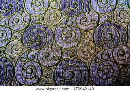 Many nice cold colors spiral texture close-up photo.