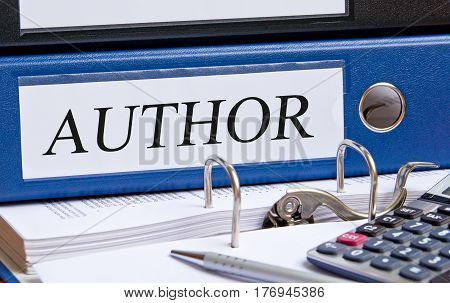 Author - blue binder with text on desk in the office
