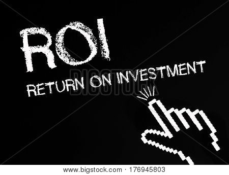 ROI - Return on Investment - hand with text on blackboard