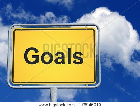 Goals - yellow sign with blue sky