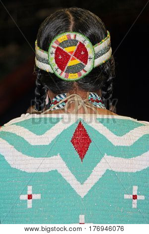 Native American Woman With Beaded Dress and Headband
