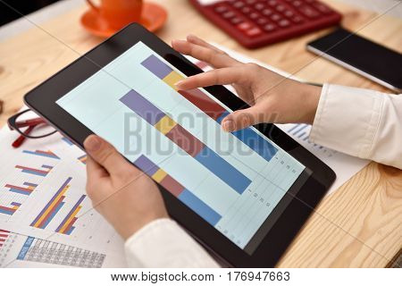 Woman Using Tablet With Financial Data