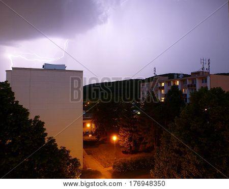 Photo of a street illuminated by lightnings