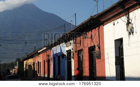 Antigua, Guatemala - 2 February 2014: Colonial houses at Antigua and vulcano Agua on Guatemala