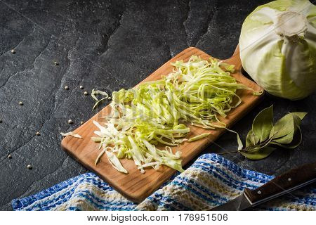 Chopped Cabbage On A Black Stone Background.