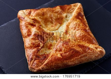 Homemade cheese puff pastries on black background. Cooking and baker. Tasty and appetizing. Delicious food. Your breakfest or dinner.