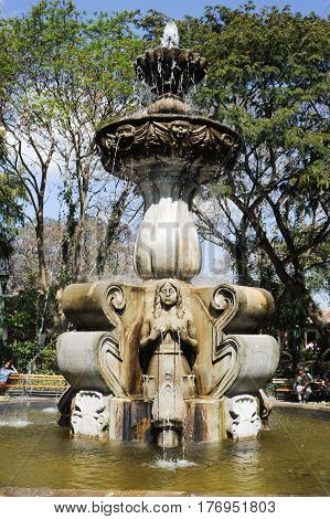 Antigua, Guatemala - 2 February 2014: The fountain of central park at Antigua on Guatemala