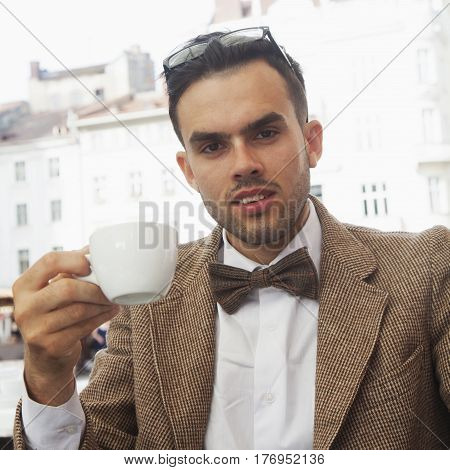 Coffee Break. Sucessful businessman enjoying in a cup of coffee