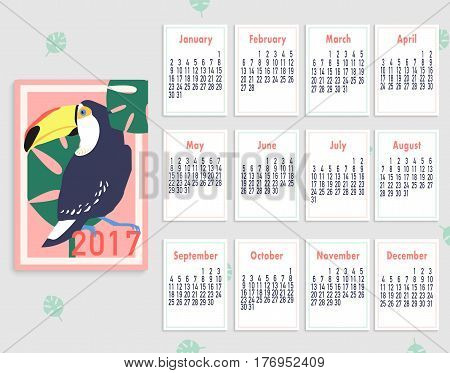 Vector tropical printable calendar 2017 with toucan. Blue, pink, yellow and green colors. Colorful cute monthly calendar. Easy to edit and ready to use.