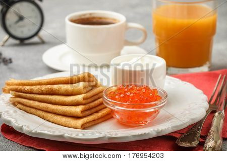 Breakfast. Thin Pancakes With Red Caviar In White Bowl On The Table. Crepes. Coffee And Juice. Selec