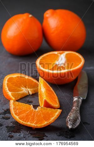 Mineola. Juicy Sweet Orange Citrus Fruit Whole And Sliced On A Black Background. Selective Focus