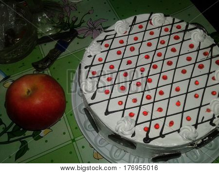 apple attribute black cake chocolate circles close confection constant cream decorated decorations dessert dots festive holiday holidays major round side standin sweet table white whole