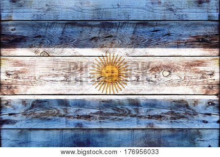 Flag of Argentina painted on grungy wood plank background