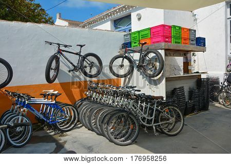 ILE D'YEU FRANCE - MAY 23 2016: Private bike rental station in yard.
