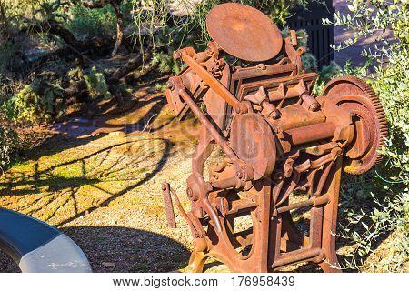 Vintage 1800's Rusted Printing Press In Arizona Desert