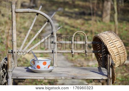 Rustic Still Life With A Cup Of Tea And Straw Hat